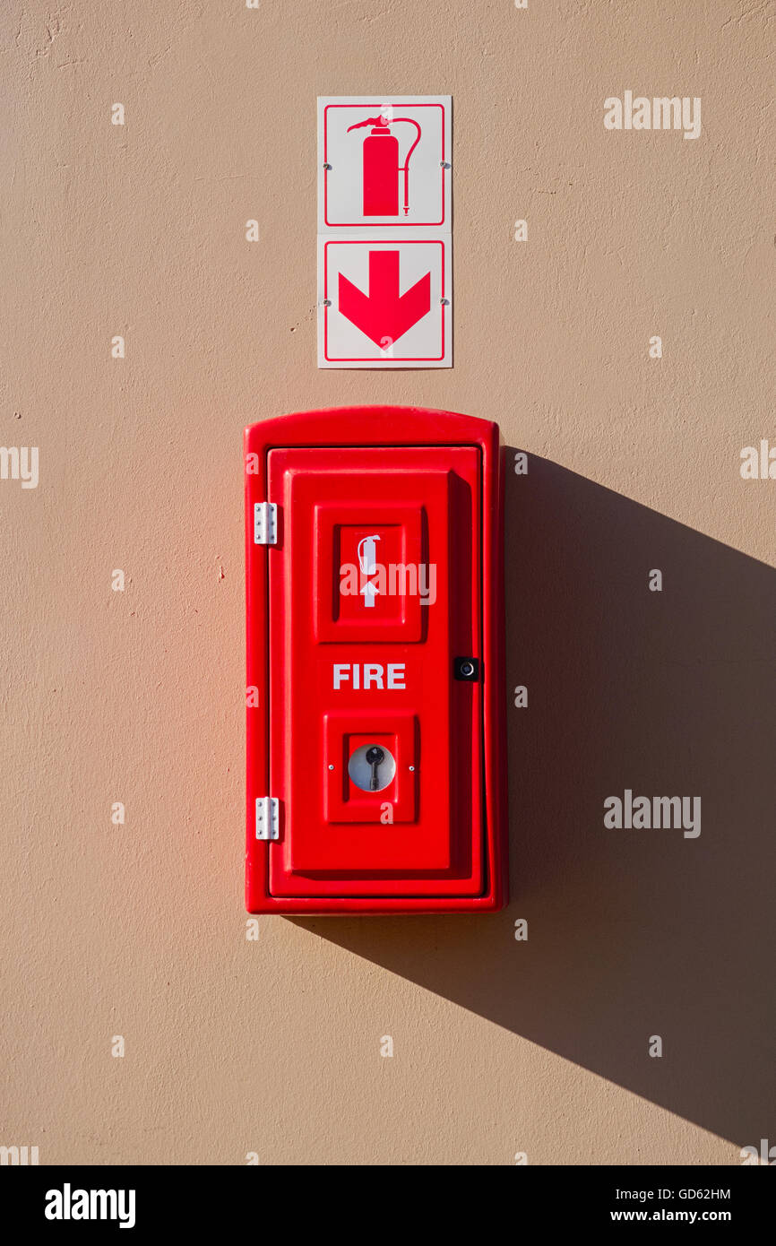 Red Fire Extinguisher Box Hanging On The Wall