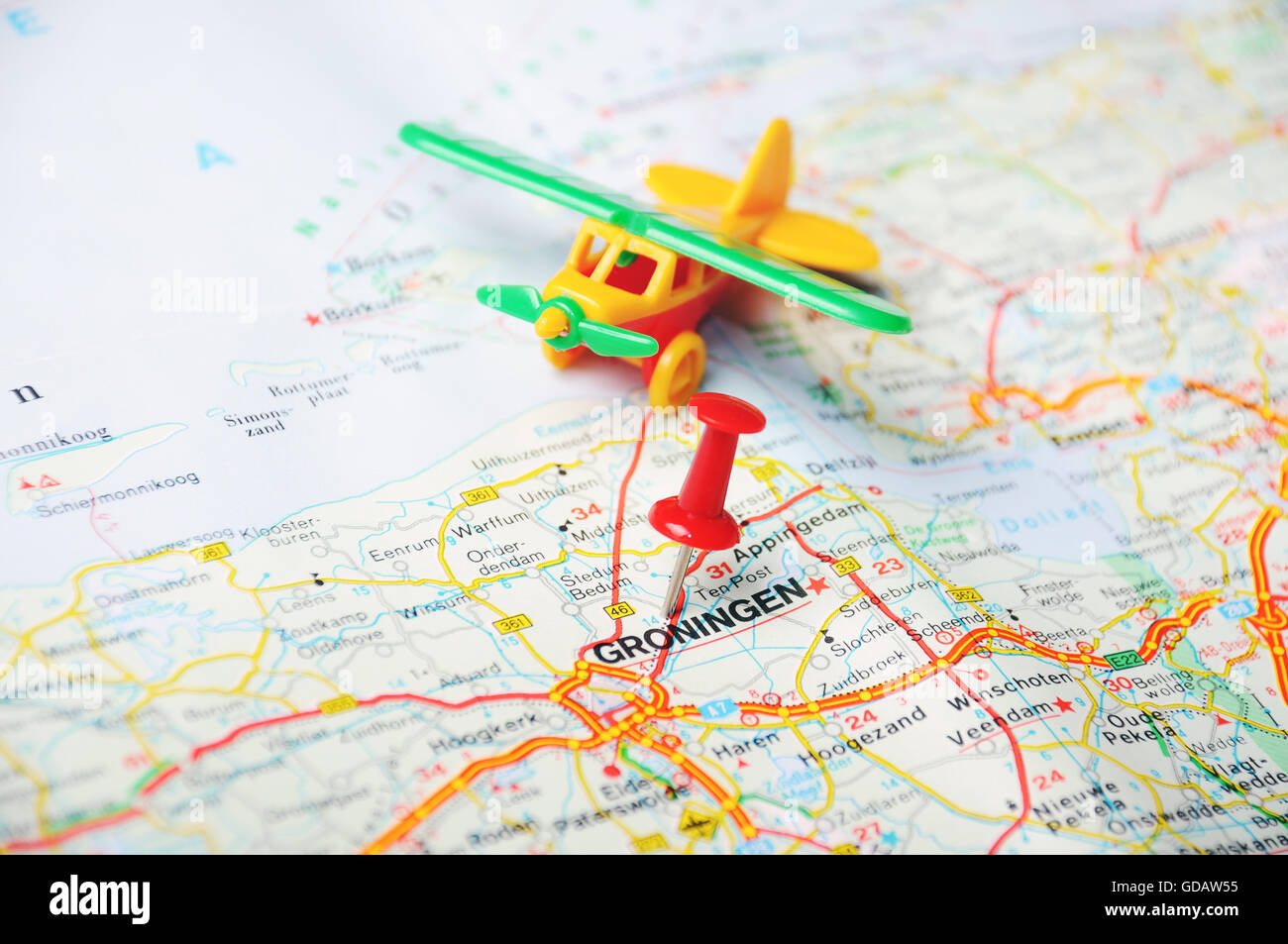 Close up of Groningen  Netherlands map with red pin and airplane