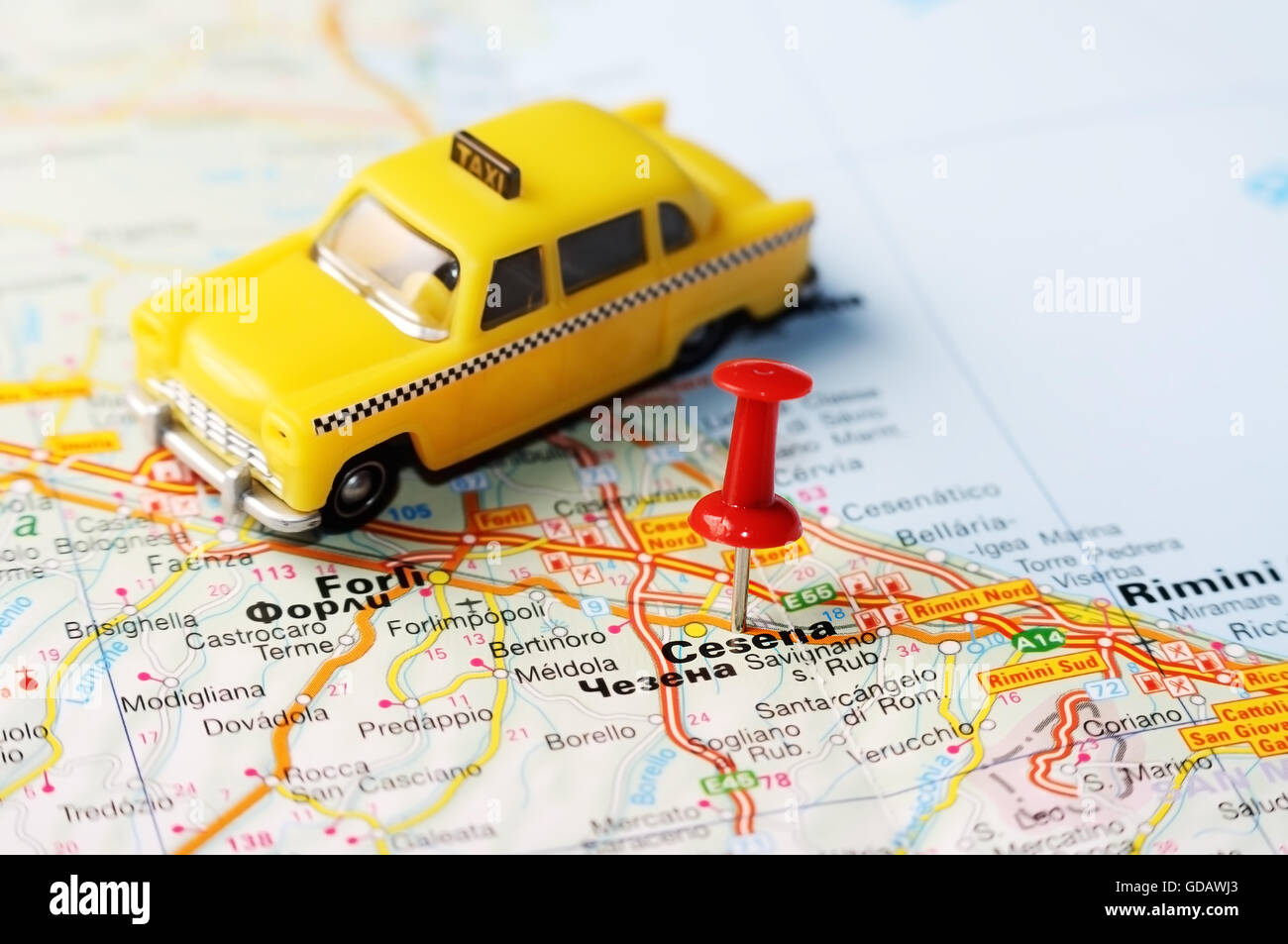 Close up of Cesena Italy map with red pin and a taxi Travel