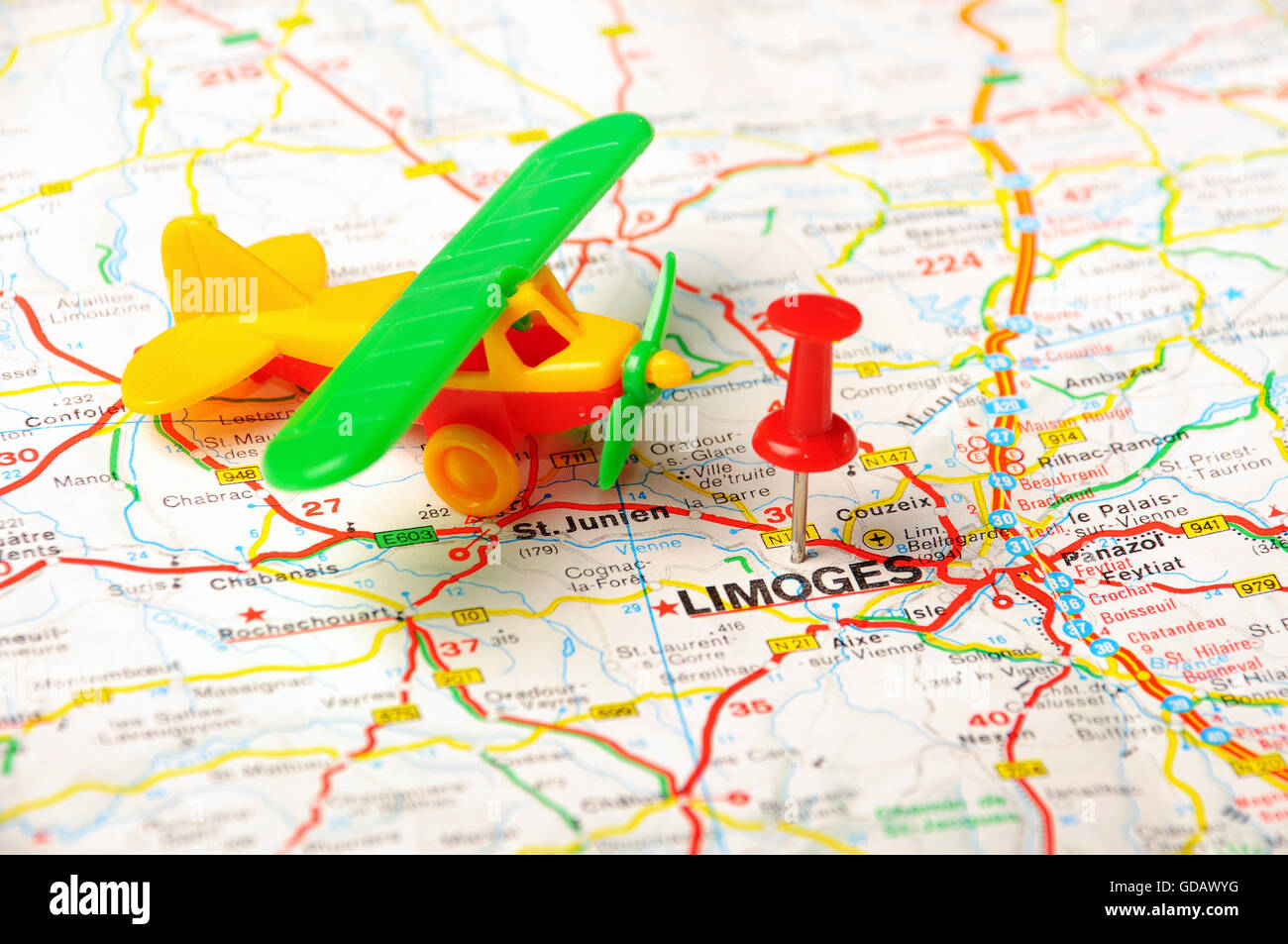 Red push pin pointing at Limoges France map and airplan Stock