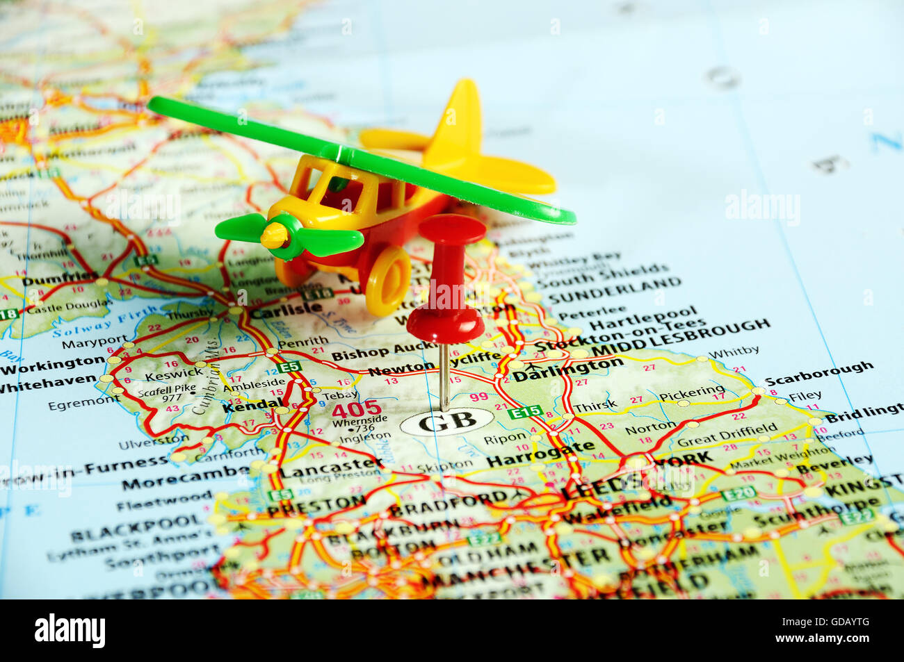 Great Britain map with red pin and airplane Travel concept Stock