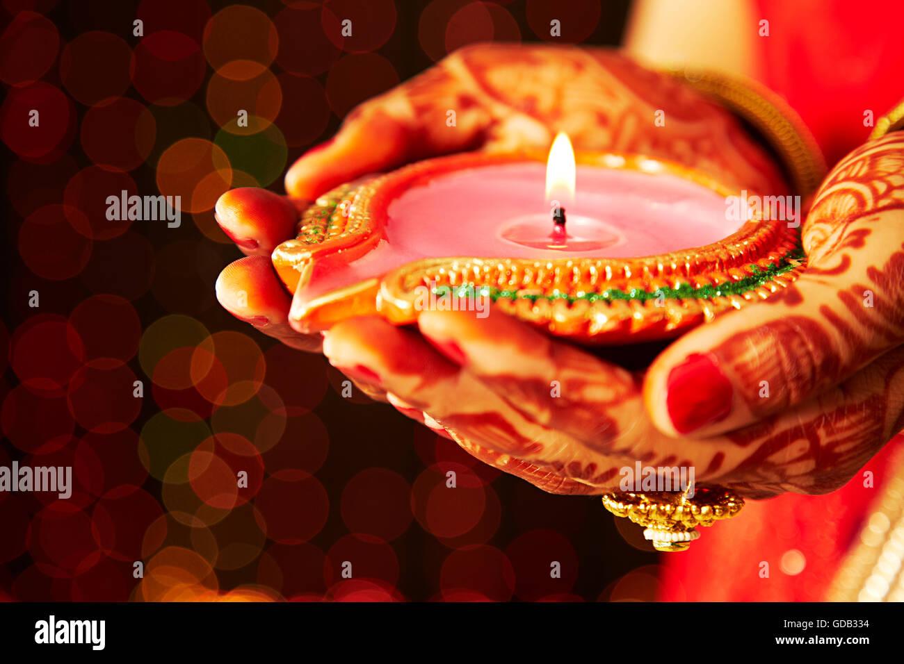 Diwali Diyas Online Shopping India: 1 Indian Adult Woman Bride Diwali Festival Hands-cupped