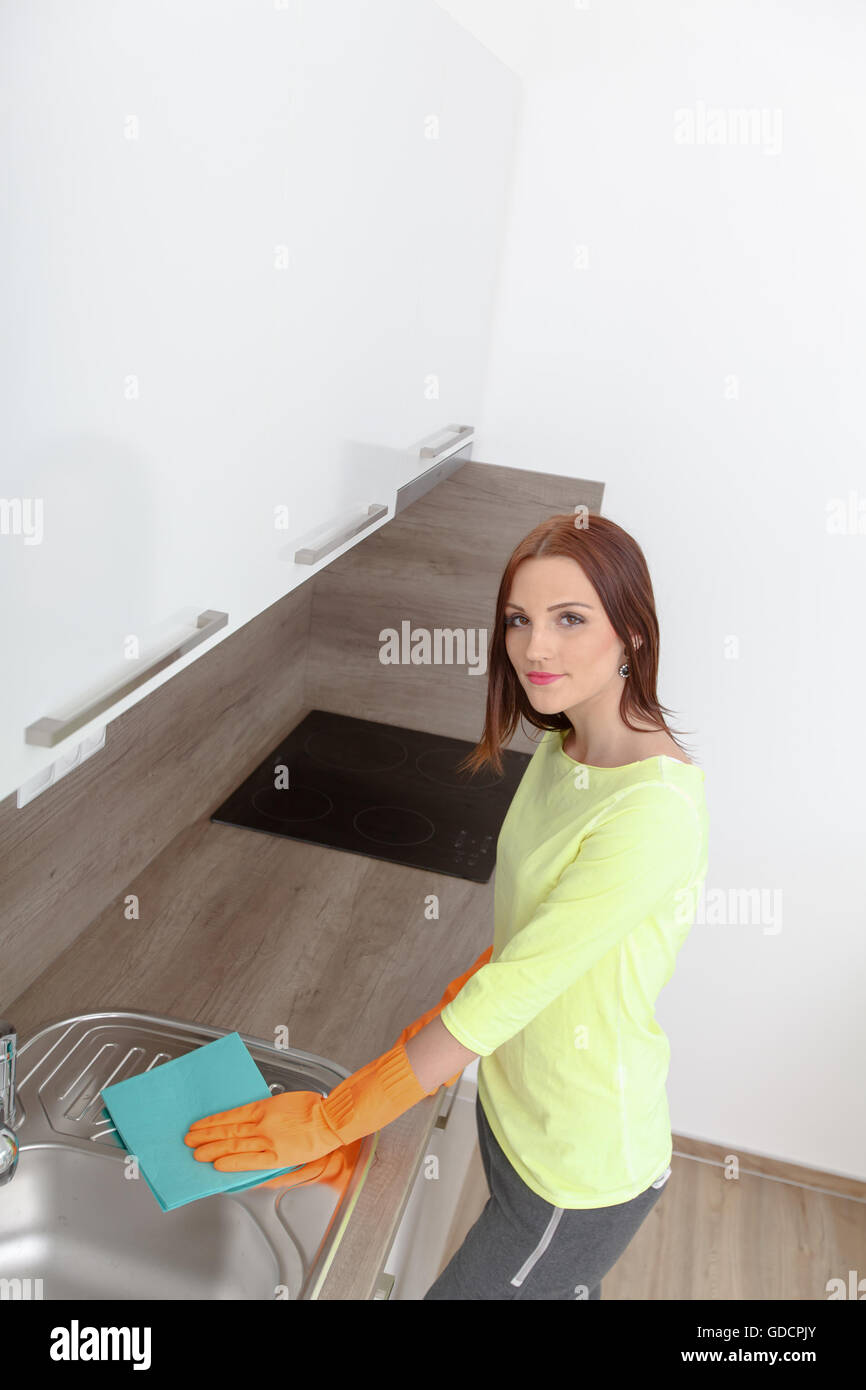 New Kitchen That Work Beautiful Young Woman At Work Using Rubber Gloves Cleans New