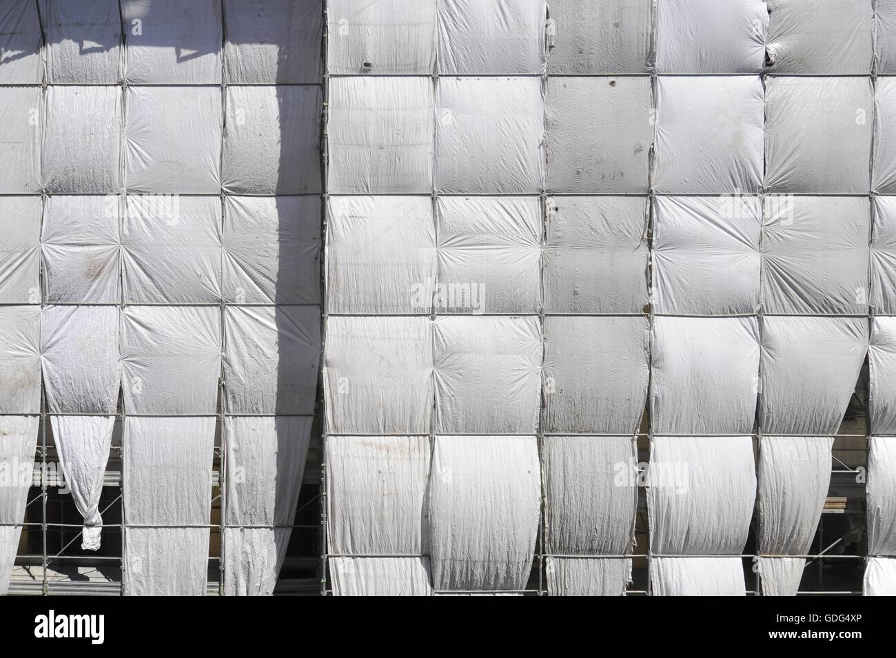 dust cover on the facade of a building under renovation stock image