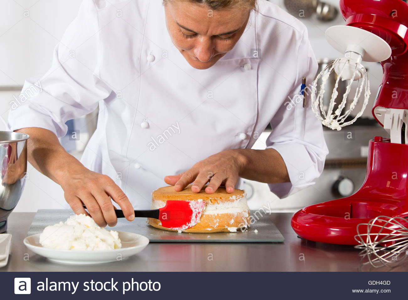 Pastry chef in the kitchen Stock Photo, Royalty Free Image ...