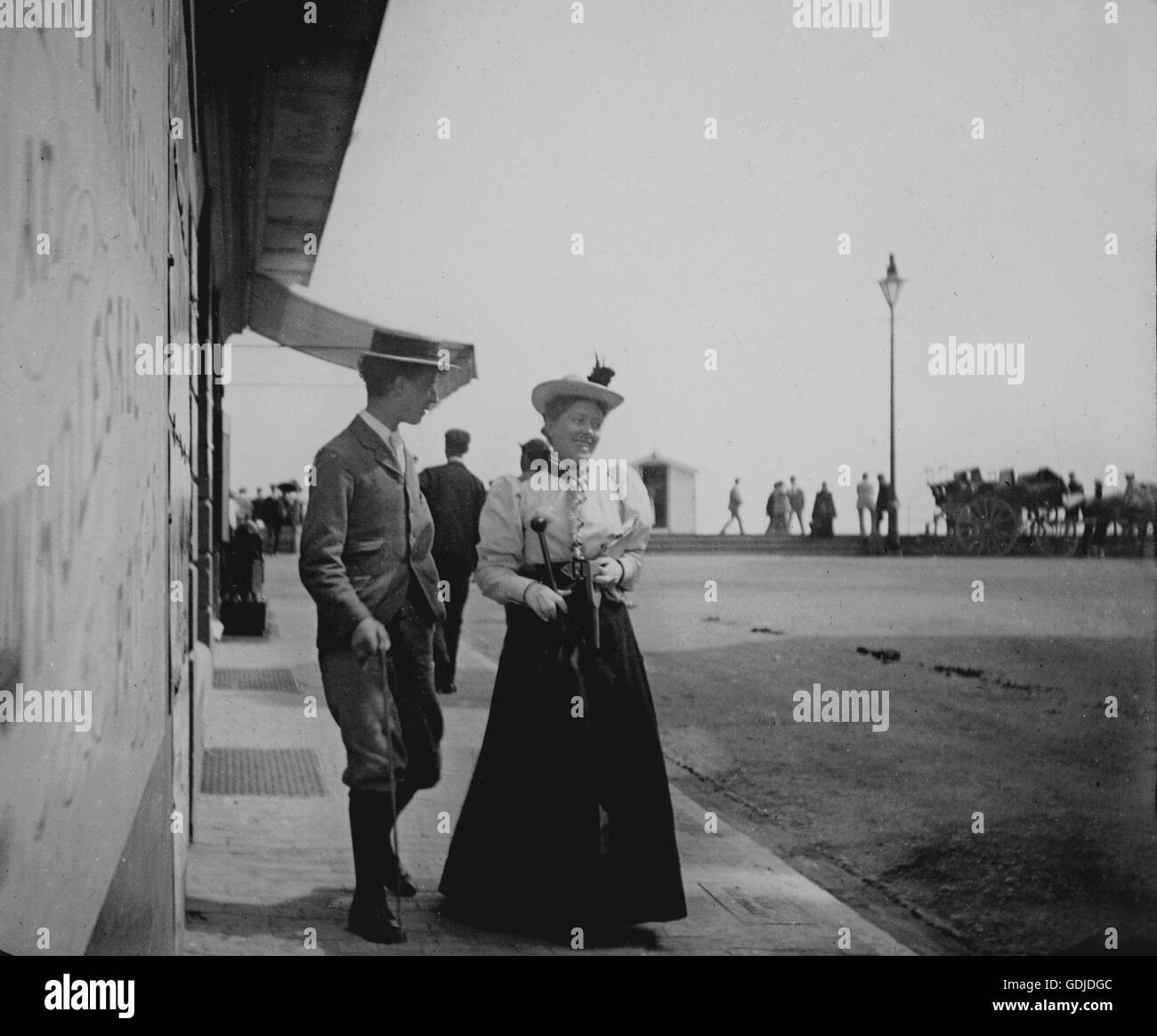 amateur young couple Amateur holiday photos c1899, a young couple on their way to the promenade,  venue appears to be Hastings. Photograph by Tony Henshaw