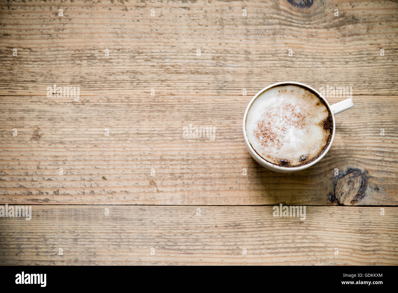 Cup of latte or cappuccino coffee on wooden table top view with cup of latte or cappuccino coffee on wooden table top view with copy space geotapseo Gallery