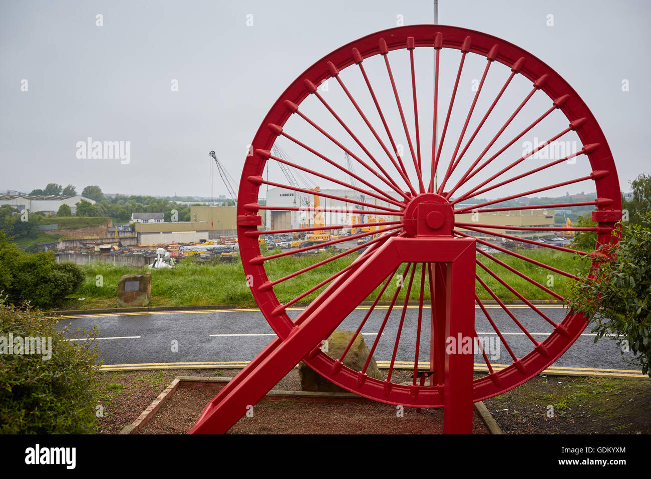 A symbolic red pit head wheel stands on the site of the former a symbolic red pit head wheel stands on the site of the former wearmouth colliery in sunderland co durham public artwork recycle biocorpaavc