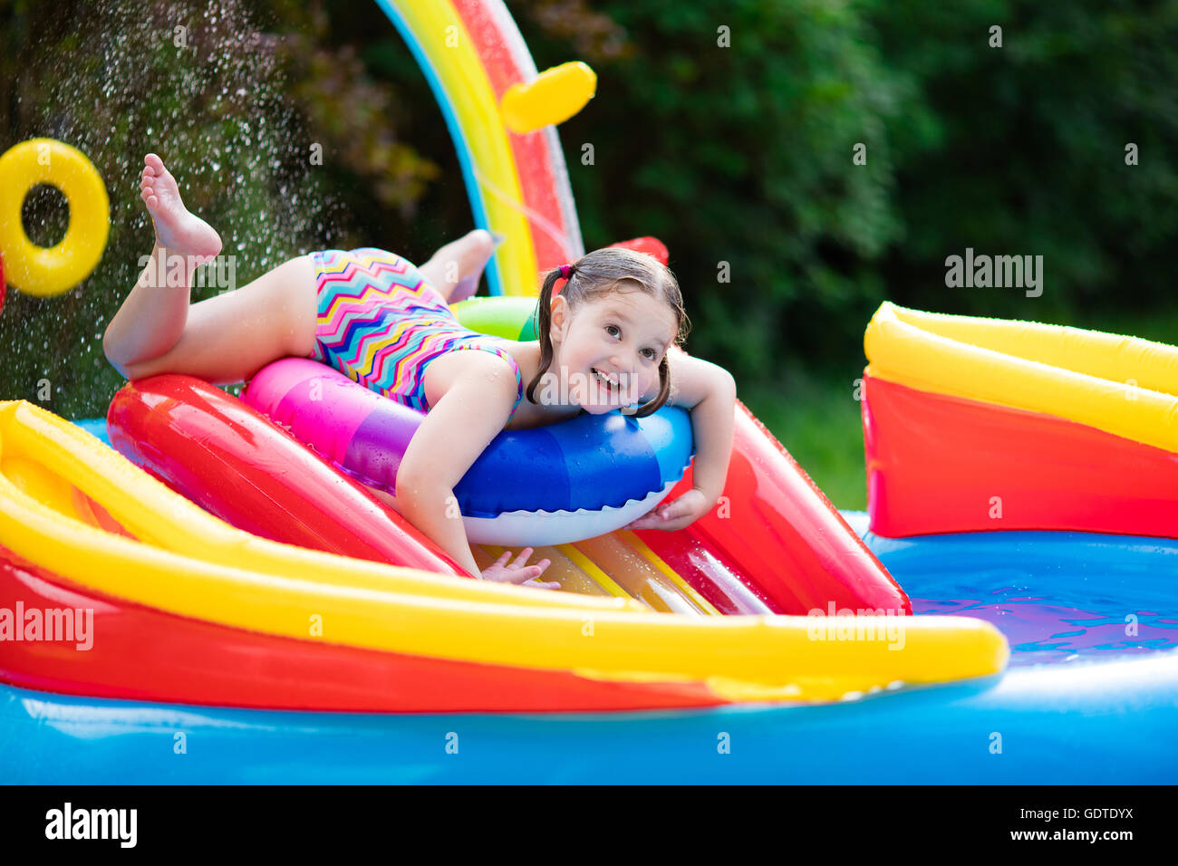 Children Playing In Inflatable Baby Pool Kids Swim And Splash In Stock Photo Royalty Free