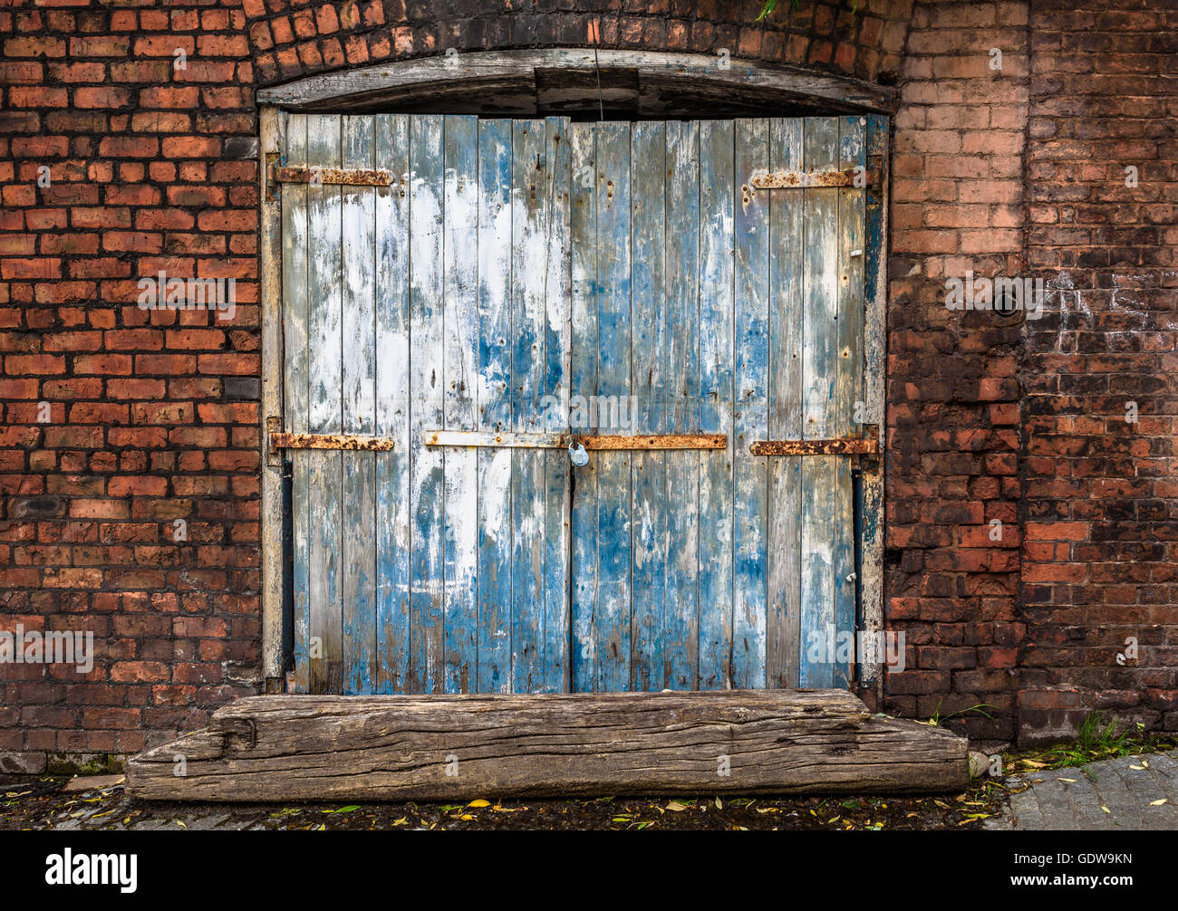 Old Brick Warehouse Shed With Grungy Wooden Doors.
