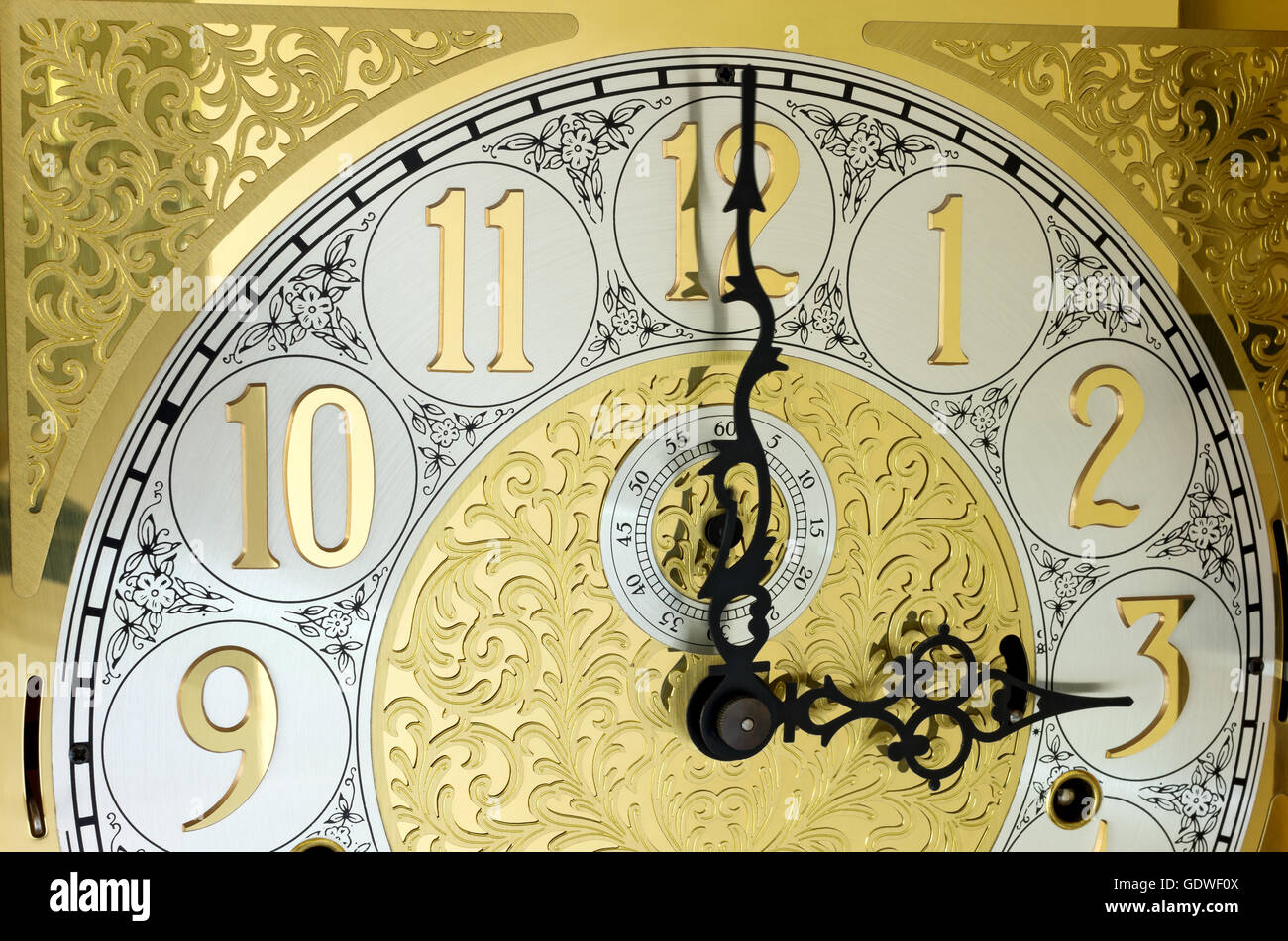 grandfather clock midnight clipart. ornate brass engraved grandfather clock face with arabic numerals and hands on three ou0027clock midnight clipart