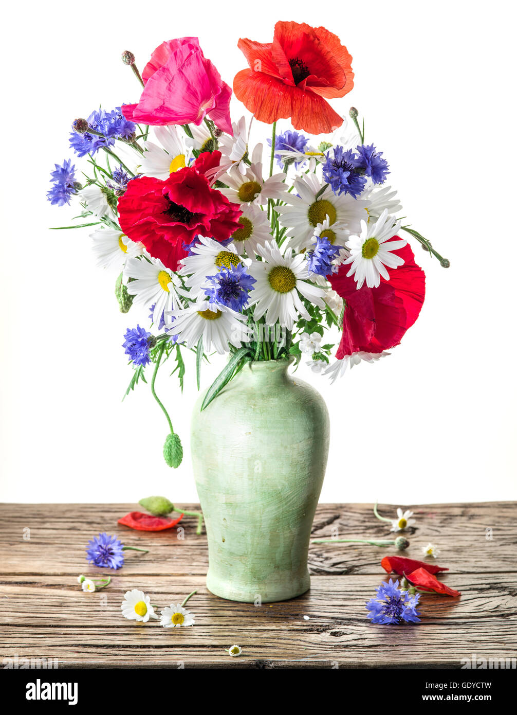 Bouquet of field flowers in the vase on the wooden table white bouquet of field flowers in the vase on the wooden table white background reviewsmspy
