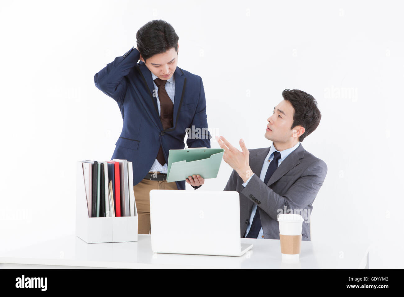 businessman being scolded by his supervisor at work stock photo businessman being scolded by his supervisor at work