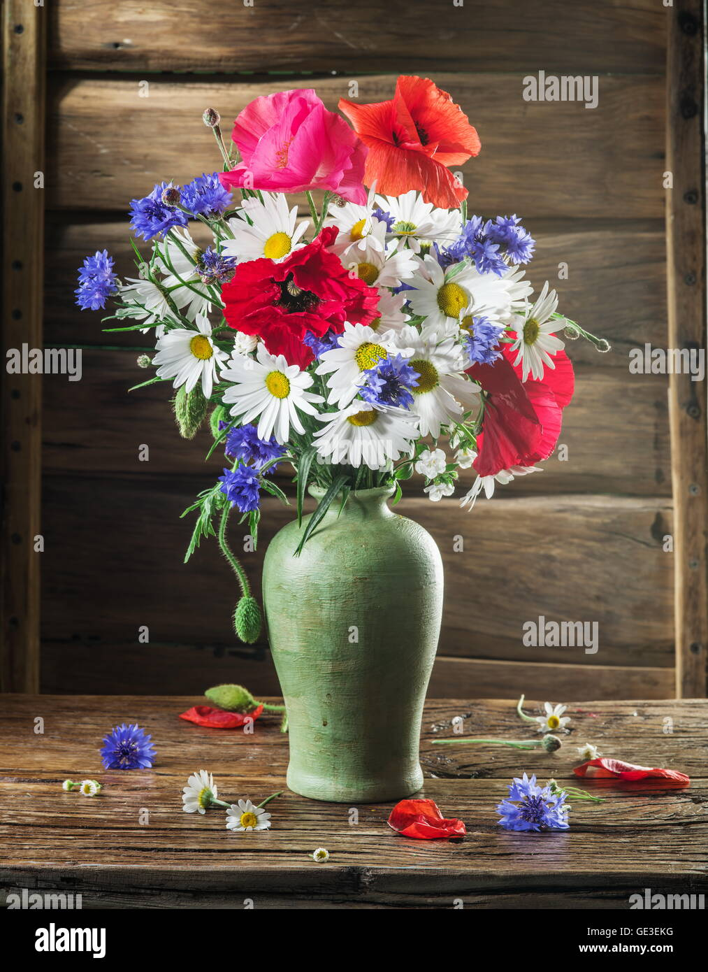 Bouquet of field flowers in the vase on the wooden table stock bouquet of field flowers in the vase on the wooden table reviewsmspy