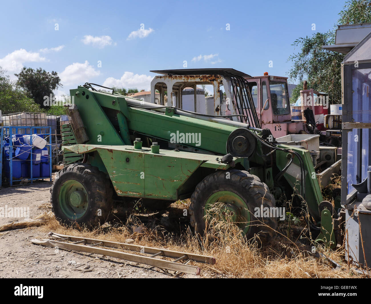 Old heavy duty forklift trucks for sale at the junkyard Stock ...