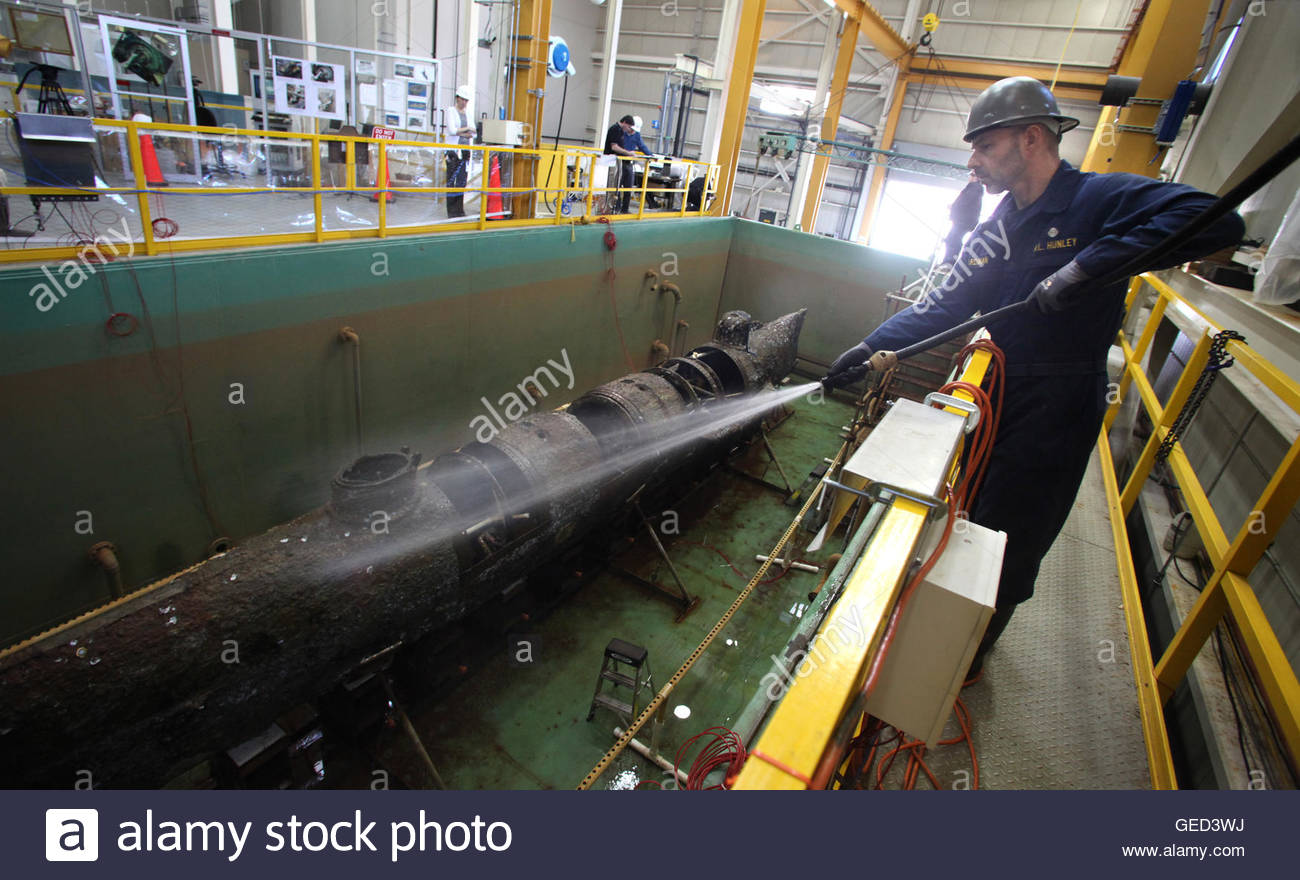 senior conservator paul mardikian wets down the civil war senior conservator paul mardikian wets down the civil war submarine h l hunley after it was d