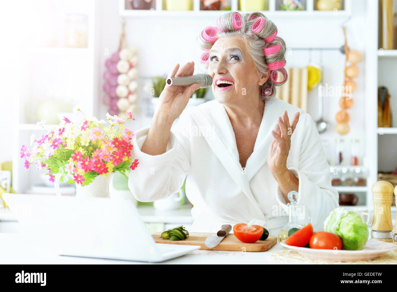 Senior woman in hair rollers at kitchen Stock Photo, Royalty Free ...