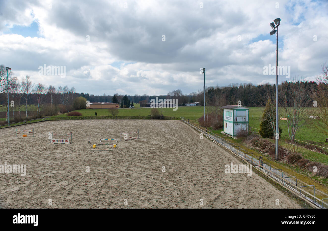 Outdoor equestrian jumping arena with flood lights at a riding outdoor equestrian jumping arena with flood lights at a riding school with a series of practice jumps for teaching and training workwithnaturefo