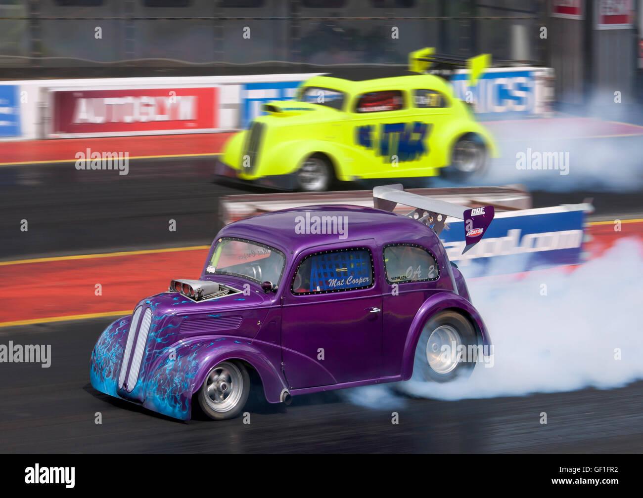 Dragstalgia vintage cars racing at santa pod mat cooper driving his outlaw ford anglia
