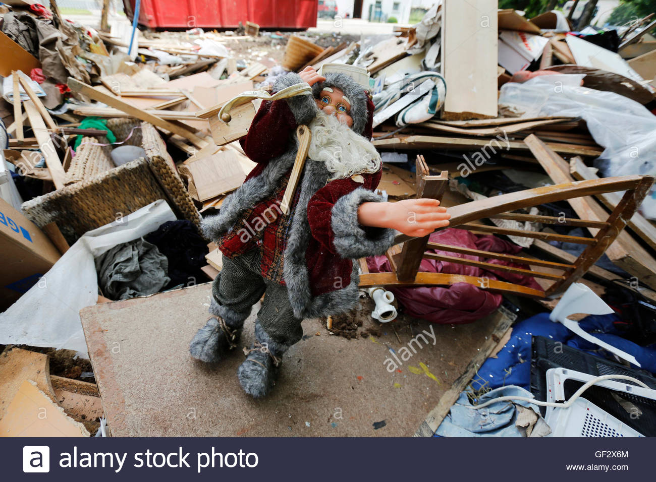 A Santa Claus Doll Is Seen Atop Furniture Destroyed By The Nearby - Furniture nearby