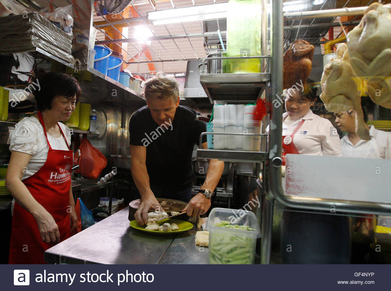 British Celebrity Chef Gordon Ramsay Plates Pieces Of Chicken As He  Prepares A Chicken Rice Dish How To Cook