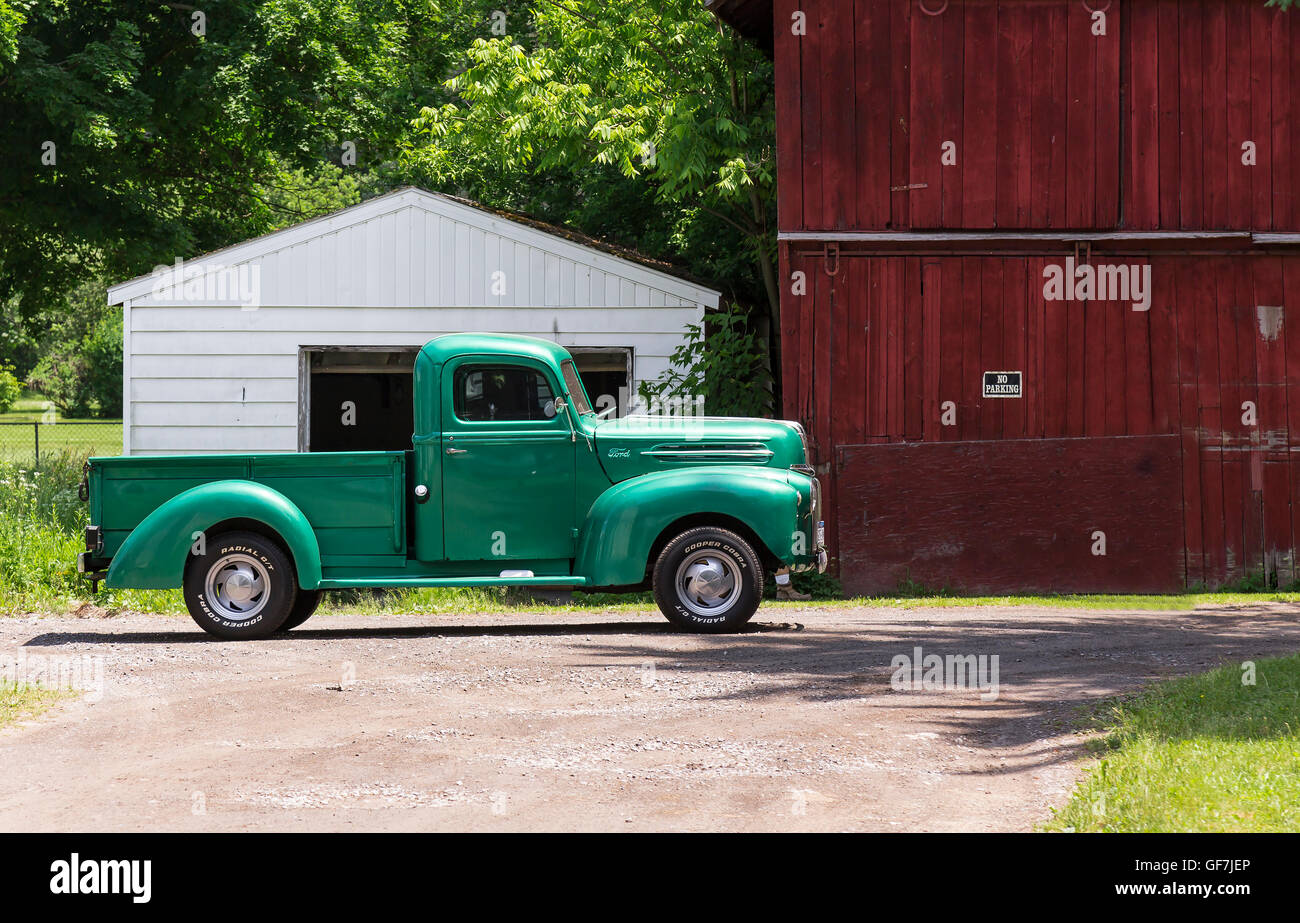 Moravia, New York - June 2016. Old classic truck in front of a red ...