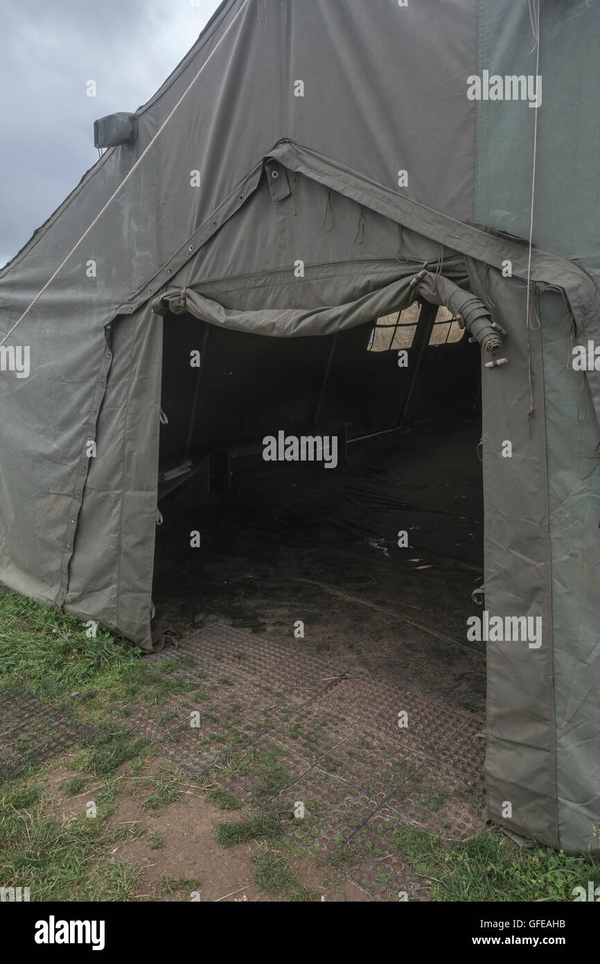 Open entrance of an old army canvas field tent showing gloomy interior & Open entrance of an old army canvas field tent showing gloomy ...