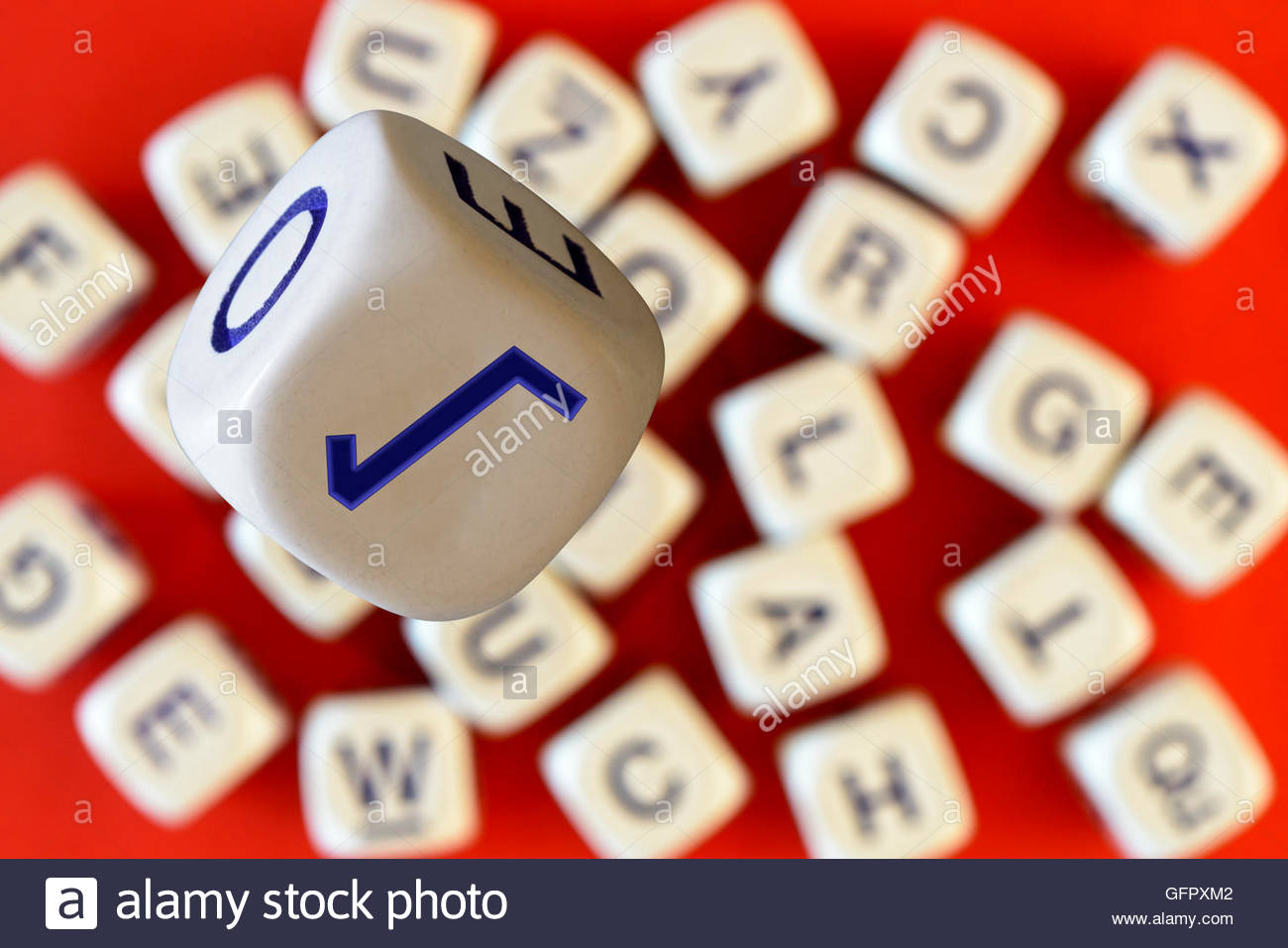 Square root symbol on the face of alphabet dice dorset england square root symbol on the face of alphabet dice dorset england britain uk buycottarizona Images