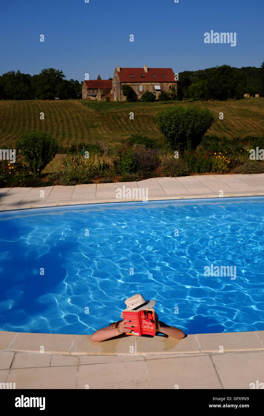 Amazing Young Woman Reading Book In Swimming Pool Holiday Gite In Le Lot Region South  West France Midi Pyrenees July 2016