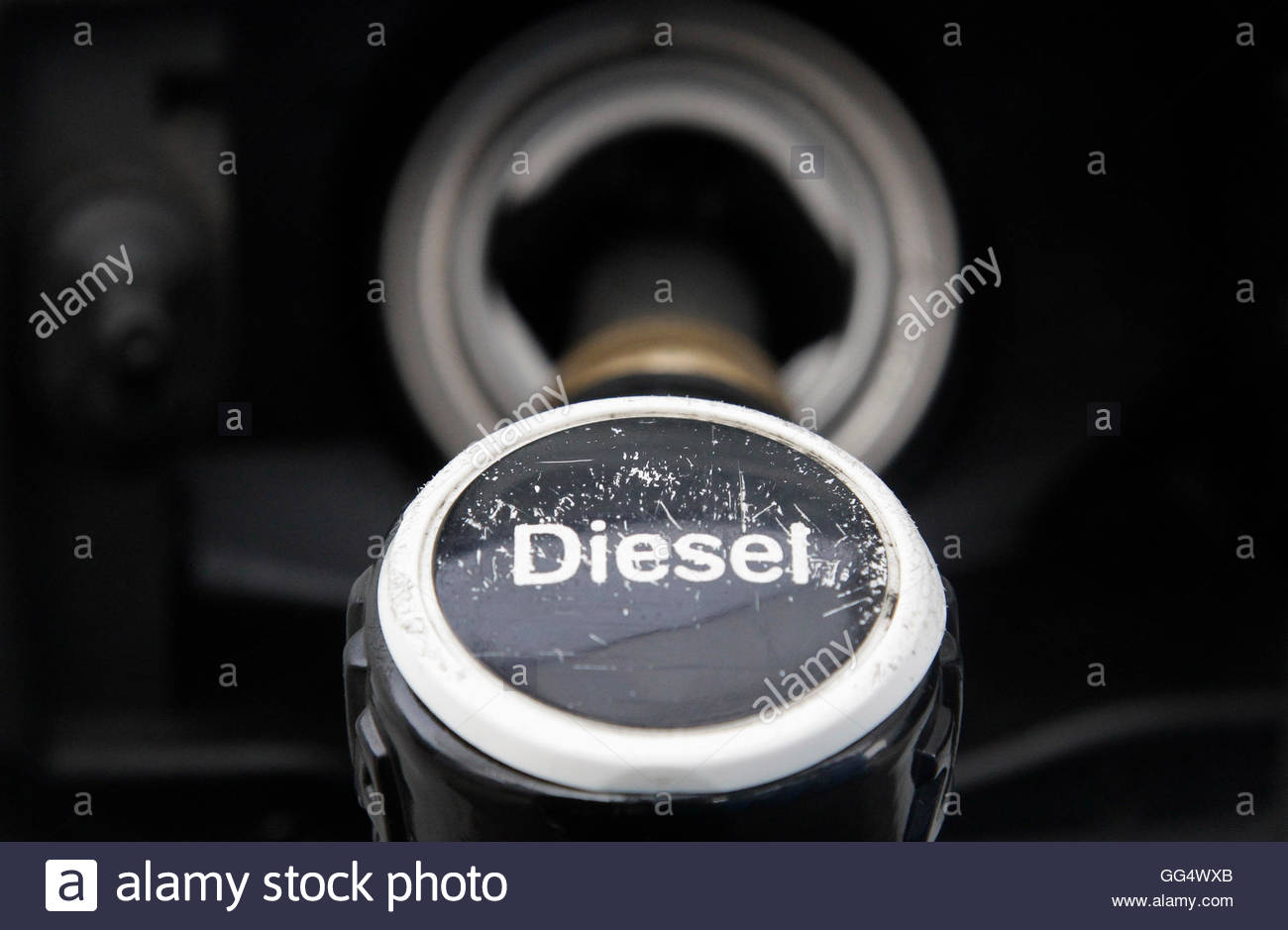 Image result for A fuel nozzle is seen at a gas station in Berlin April 3, 2012.