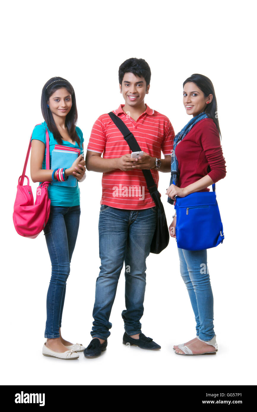 Full Length Portrait Of College Students With Books And Bags Against White Background