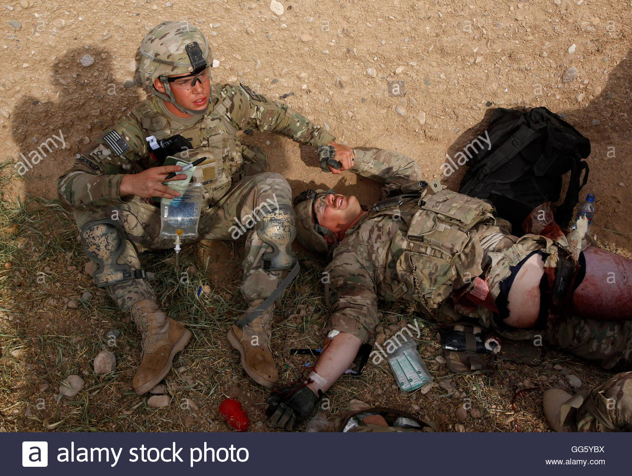 U.S. Army dog handler Aaron Yoder (R) is treated by Private first ...