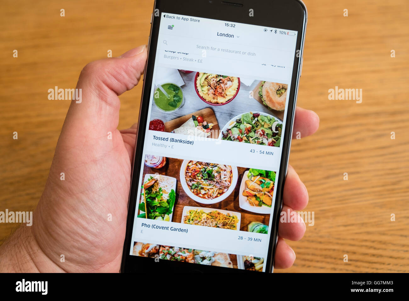 Ubereats app for restaurant delivery services in london show on an ubereats app for restaurant delivery services in london show on an iphone 6 smartphone forumfinder Image collections