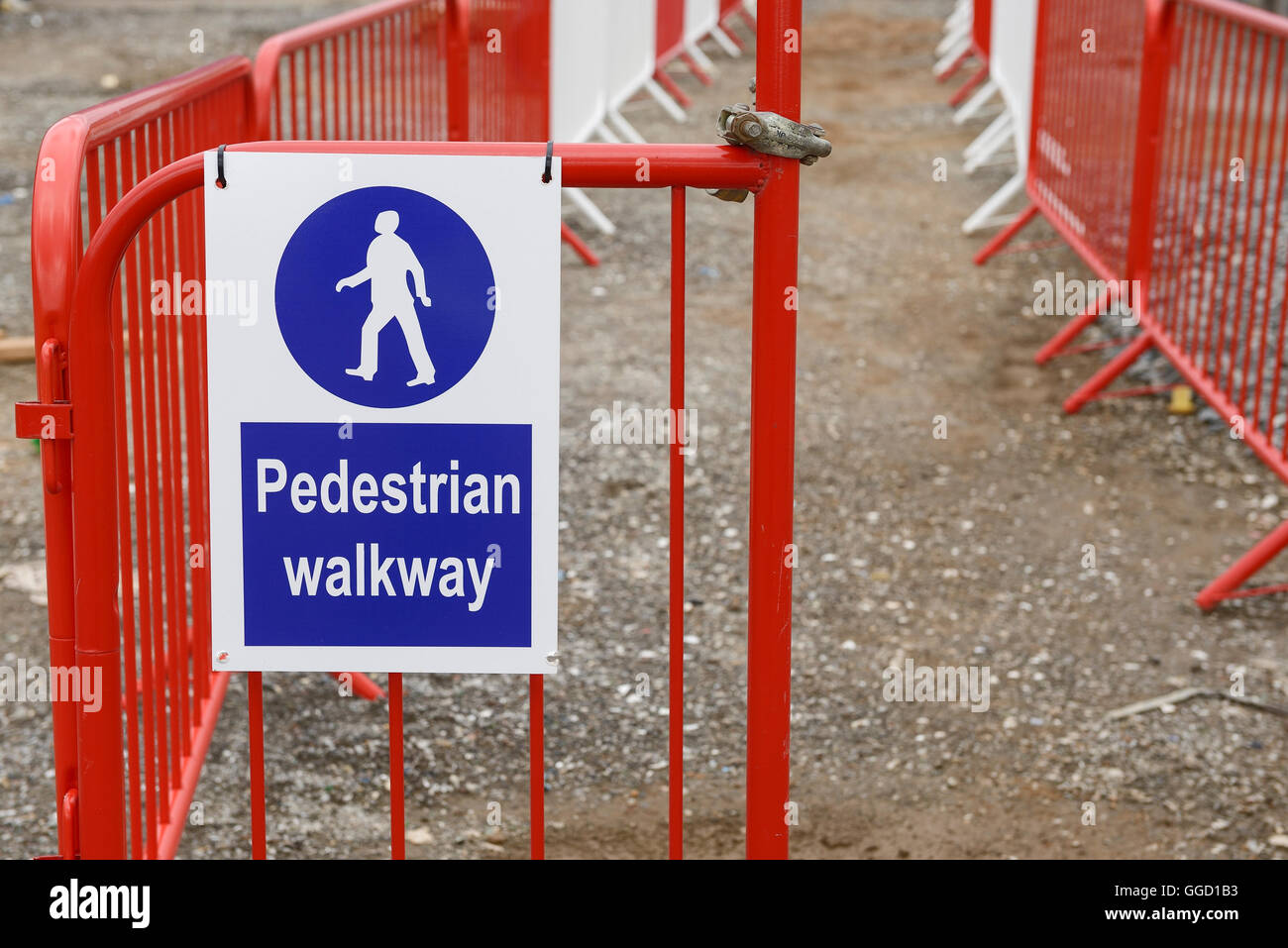 Pedestrian walkway sign and barriers on a UK construction