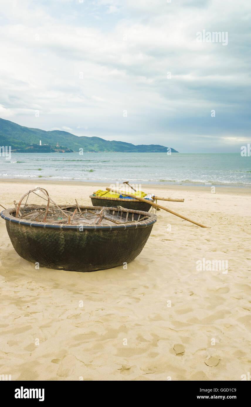 Bamboo waterproof round fishing boat on the china beach for Round fishing boat