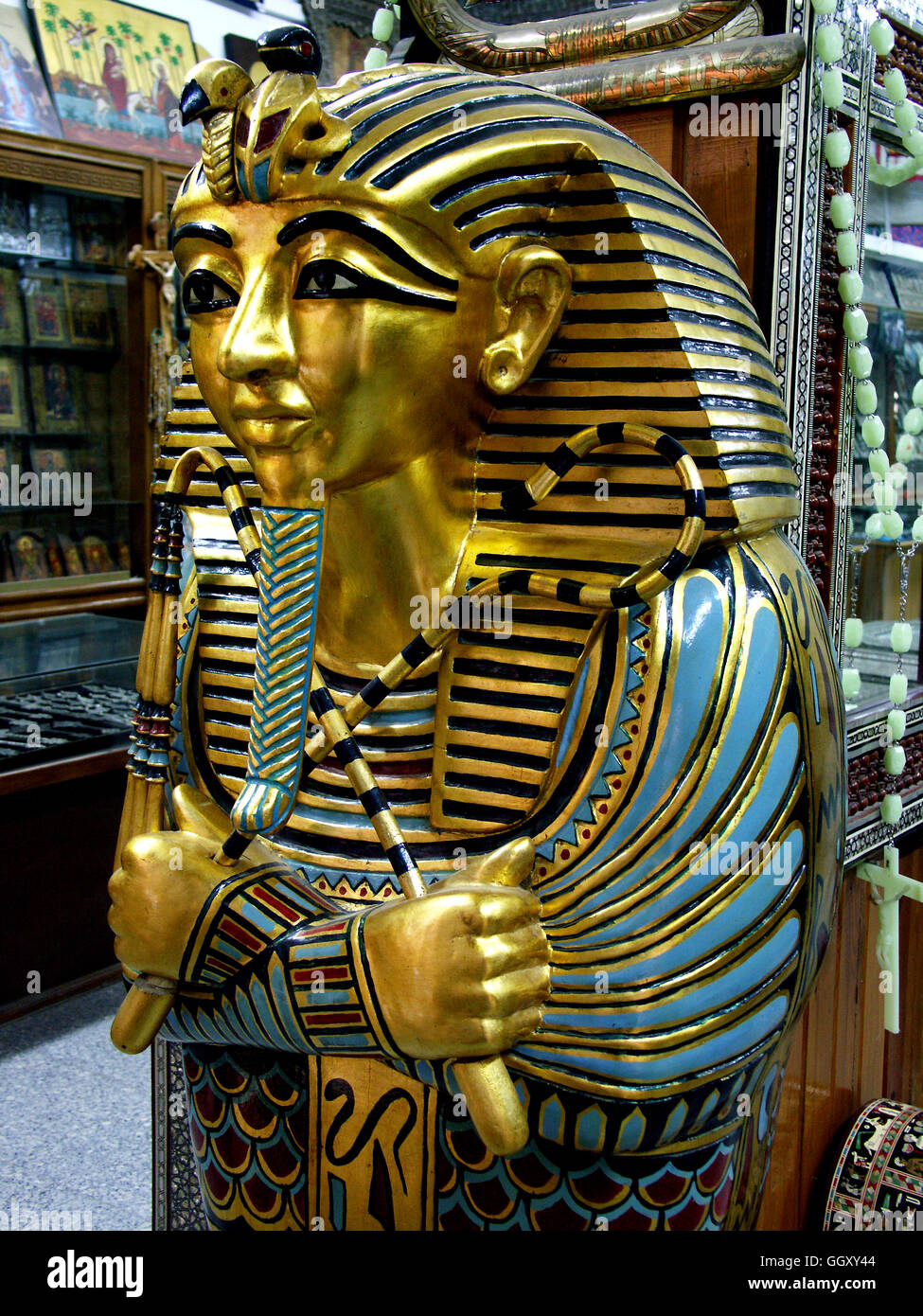 Stock Photo   Store In The Coptic Neighborhood Of Cairo Selling Furniture  Modeled After Ancient Egyptian Artifacts. Mummy Case Of Tutankhamon