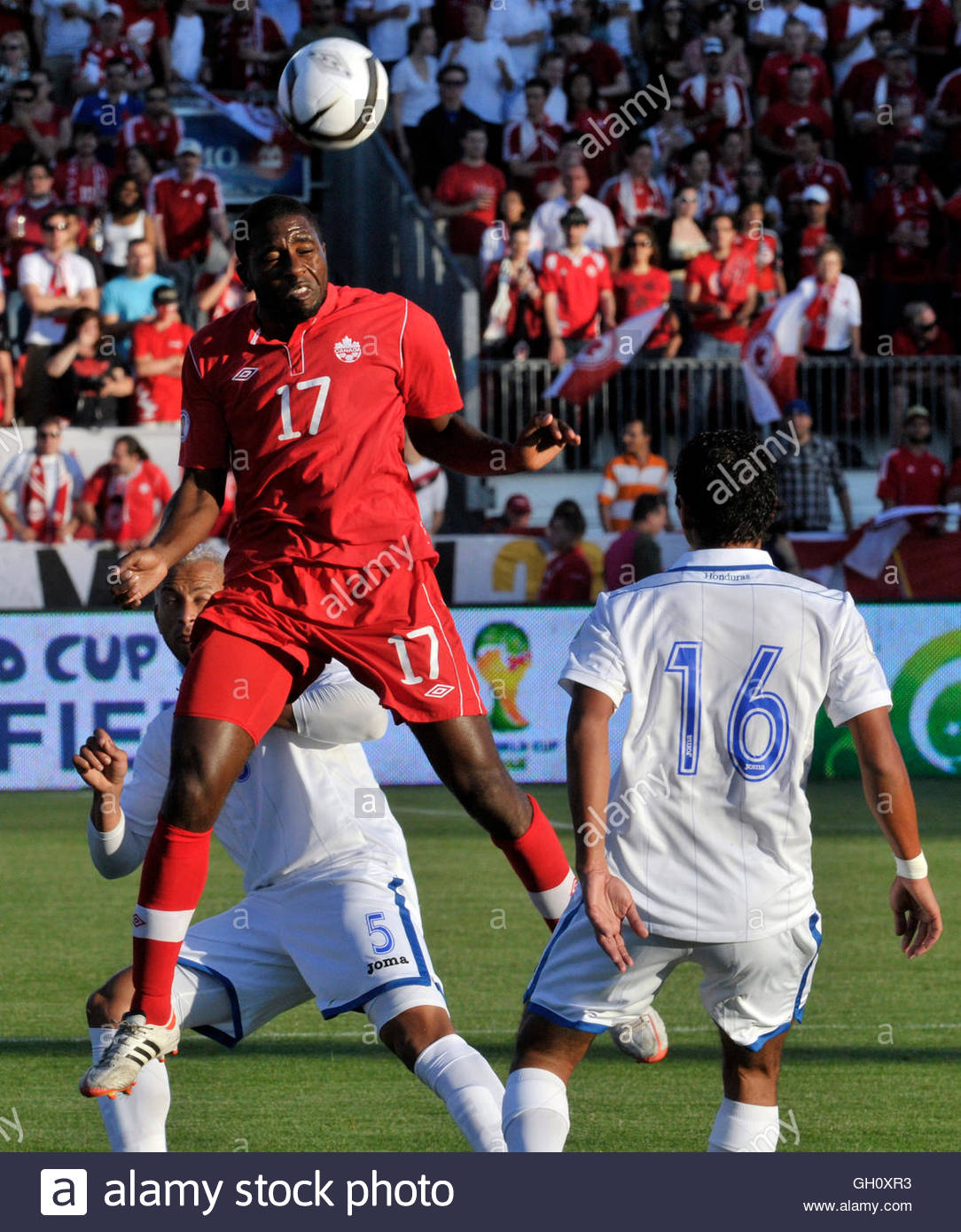 s olivier occean c heads the ball between s olivier occean c heads the ball between players victor bernandez and mauricio sabillon r during the first half of their world cup