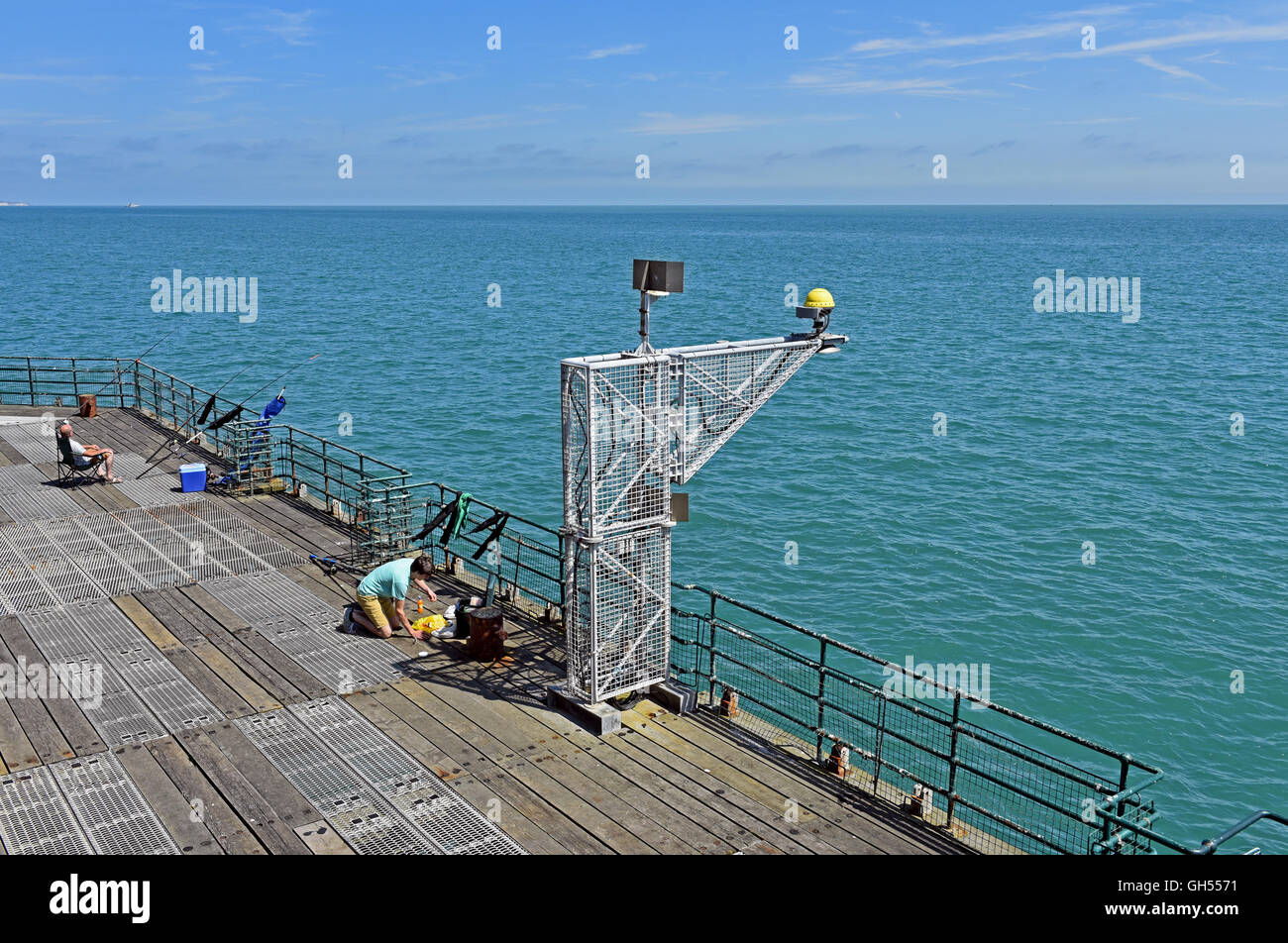 People Fishing Off The Pier On The English Coast At Deal In Kent