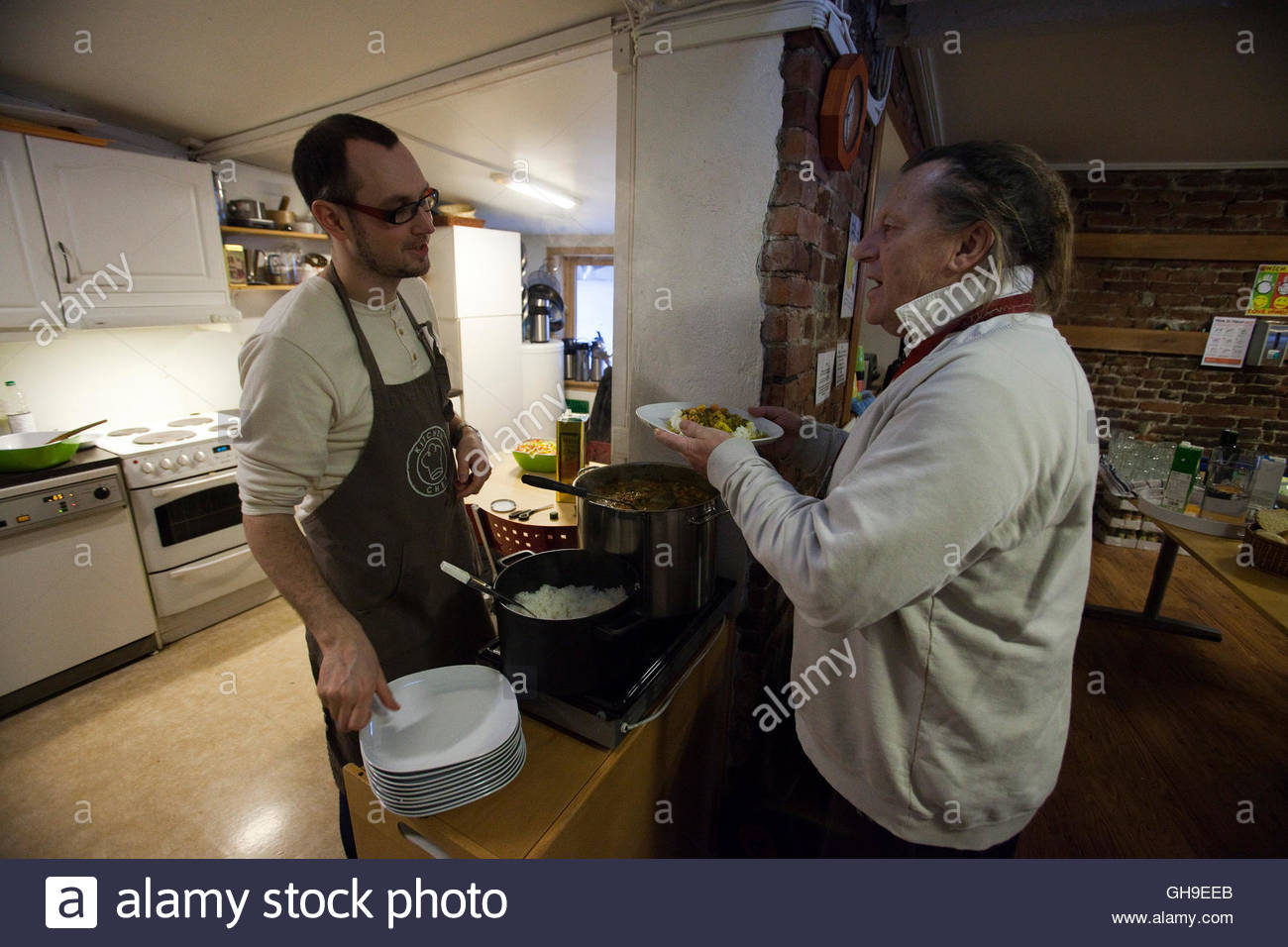 Marcos Amano (l), Manager Of The Robin Hood Foundation Serves Lunch To A