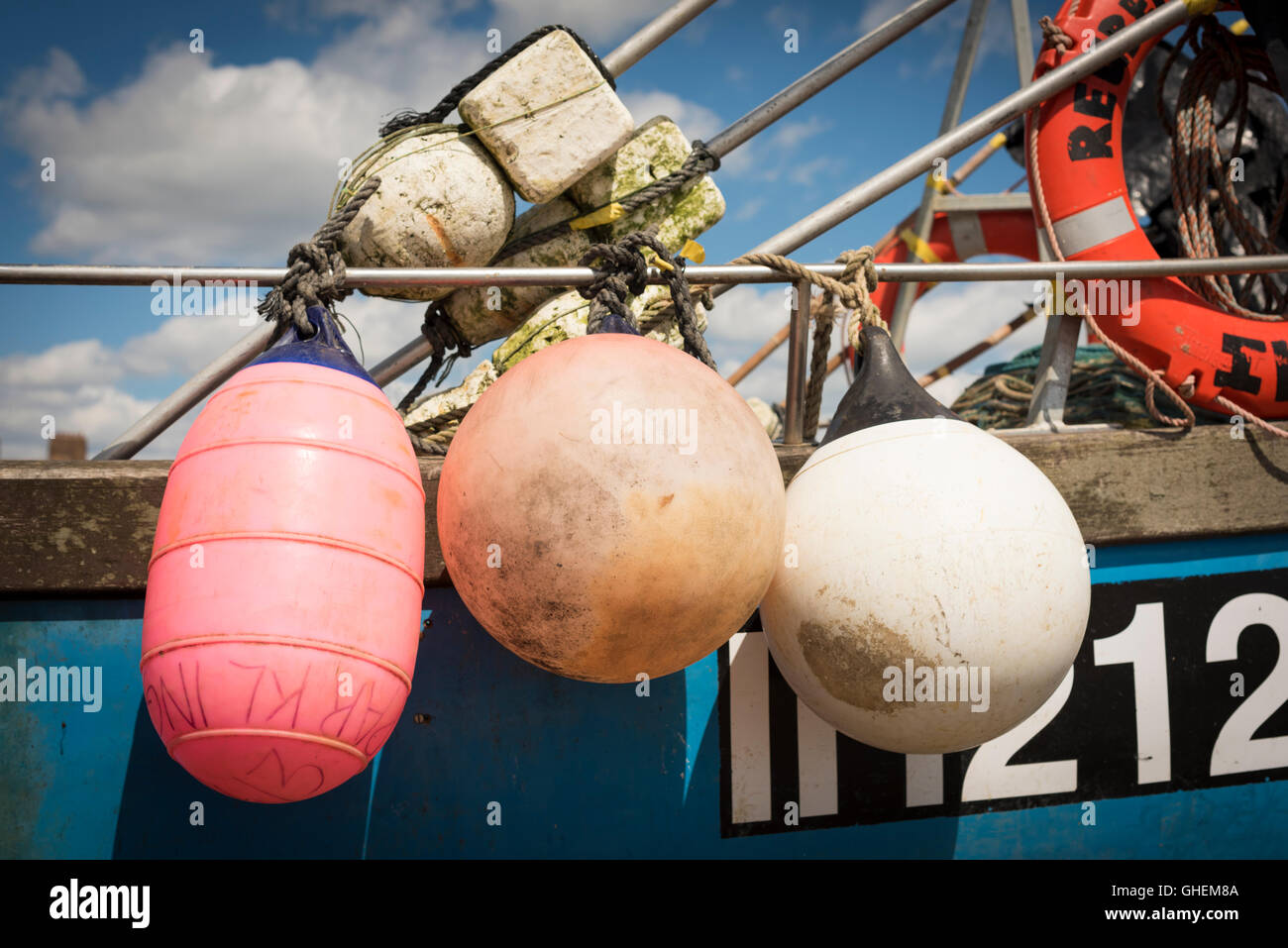 A close up fishing buoys and floats on a commercial ...