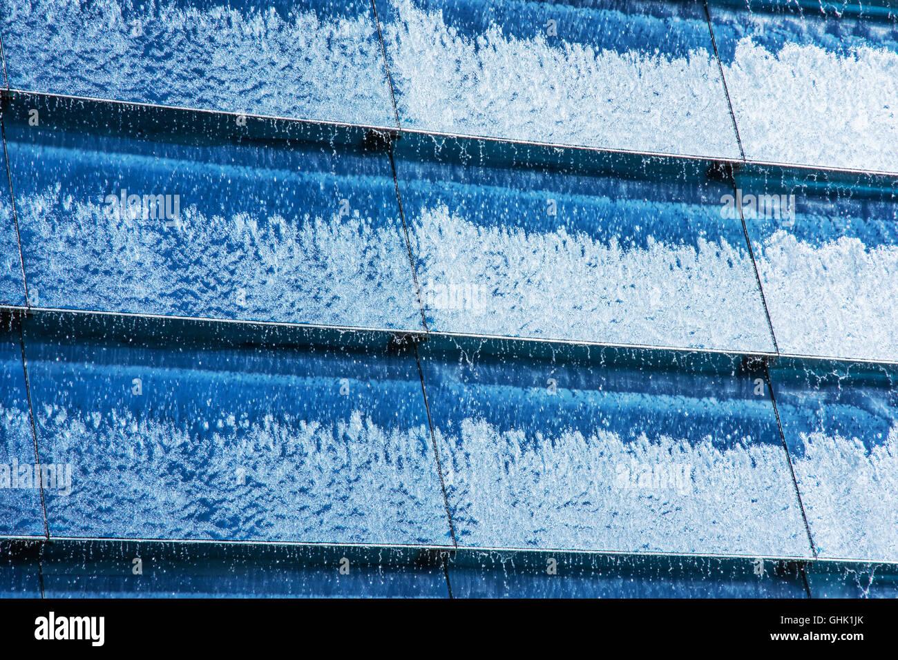 Modern Architecture Detail blue water cascade background. modern architecture detail