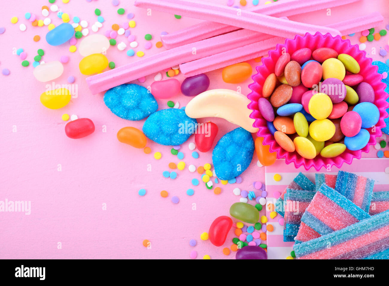 bright colorful candy background on pink wood table for