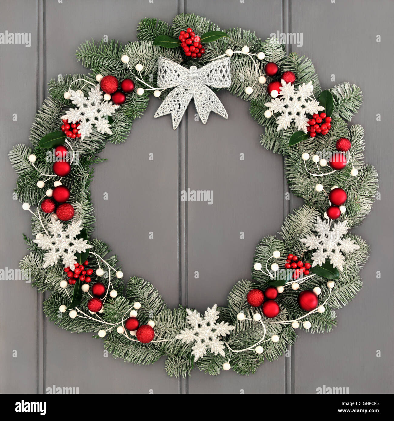 christmas wreath decoration with silver bow red bauble and white