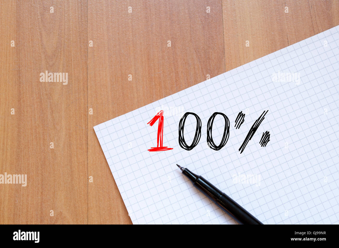One hundred percent symbol text concept write on notebook stock one hundred percent symbol text concept write on notebook buycottarizona Image collections