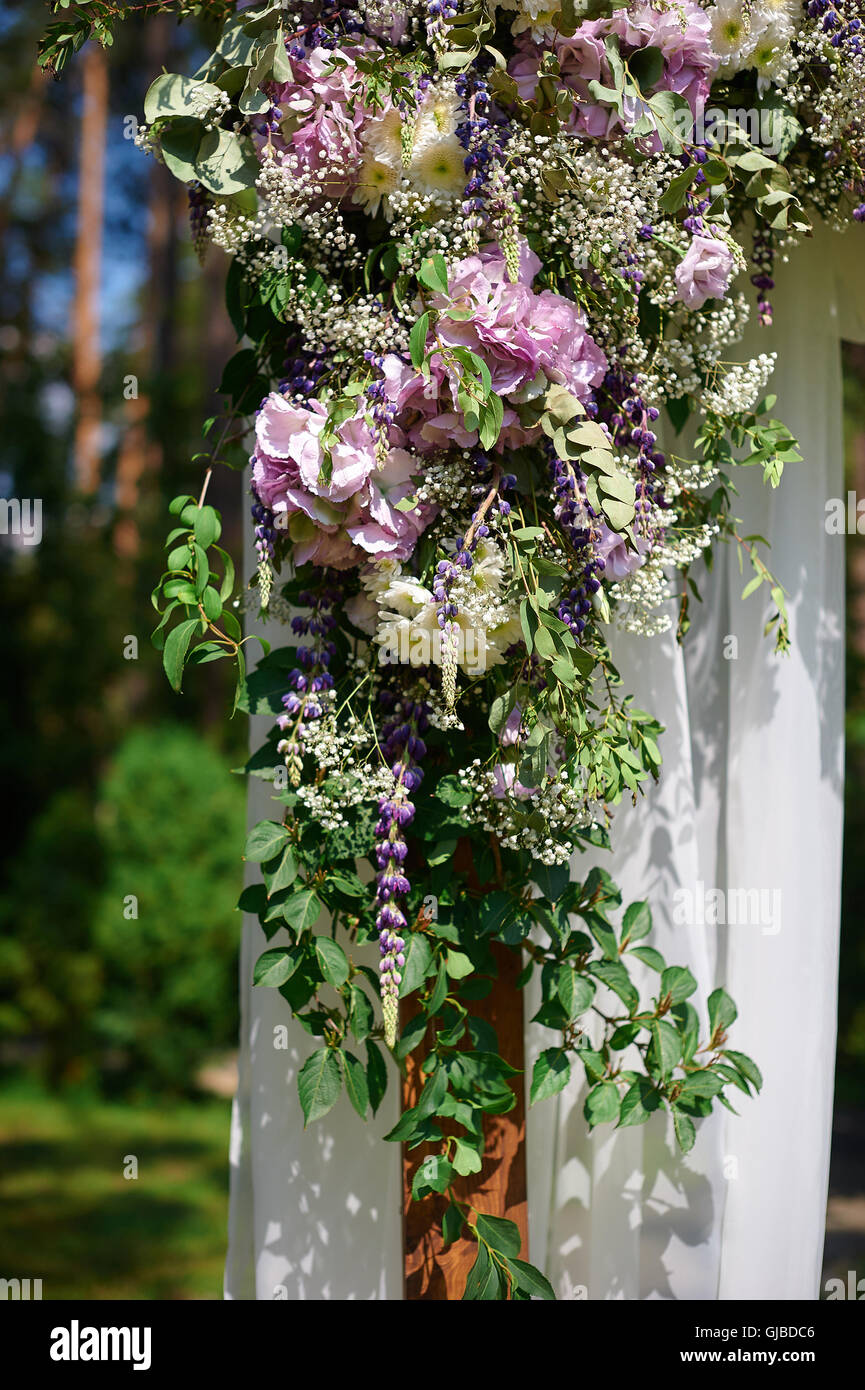 Wedding arch decorated with flowers and glass hanging vases stock wedding arch decorated with flowers and glass hanging vases reviewsmspy
