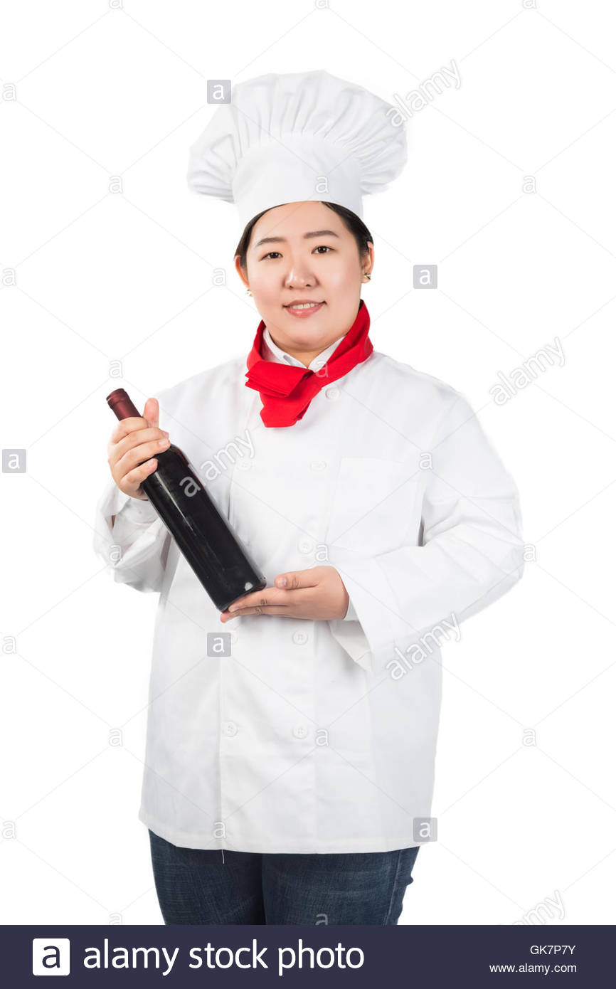 Attractive Young Cook Or Waiter Holding A Bottle Of Champagne