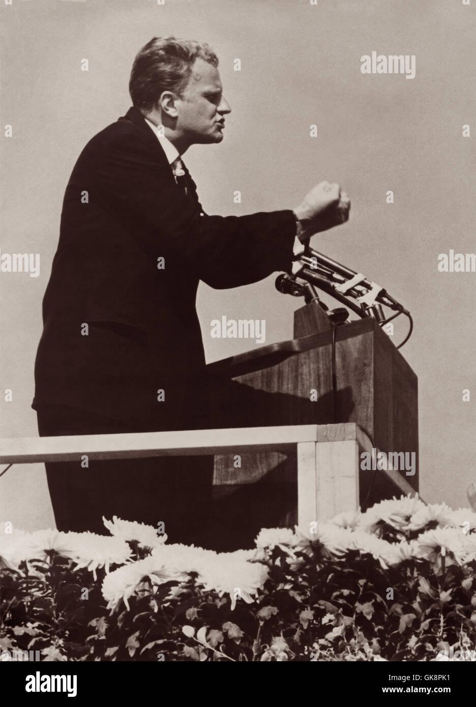 American evangelist Billy Graham preaching a Gospel ...