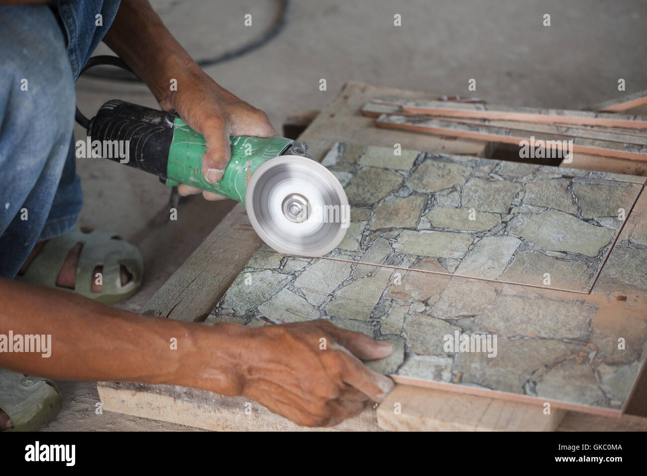 Cut ceramic tile with grinder