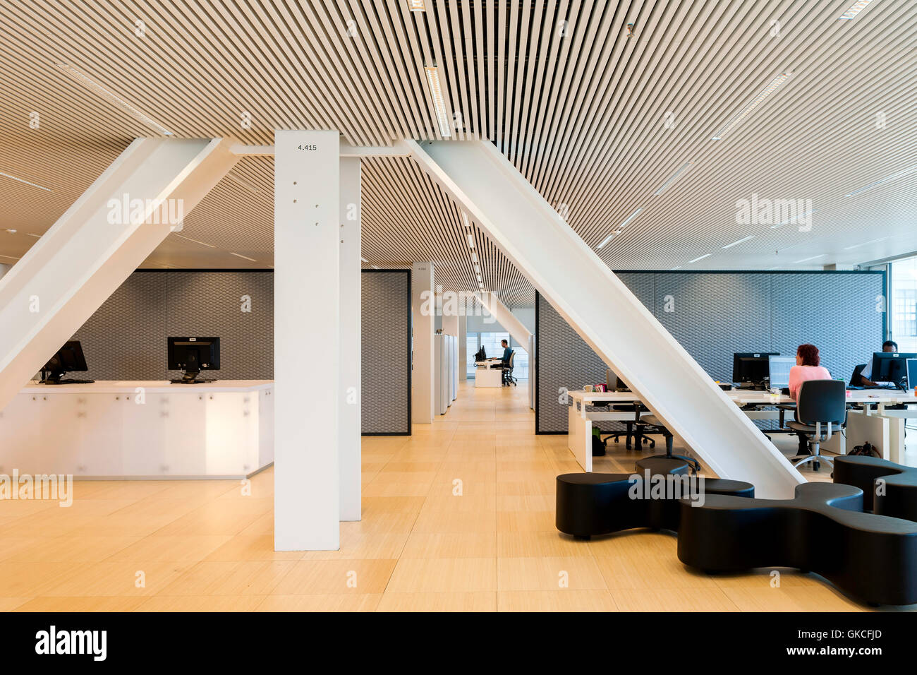 Interior view of office area showing integrated structural pillars.  Timmerhuis, Rotterdam, Netherlands. Architect: OMA Rem Koolhaas, 2015