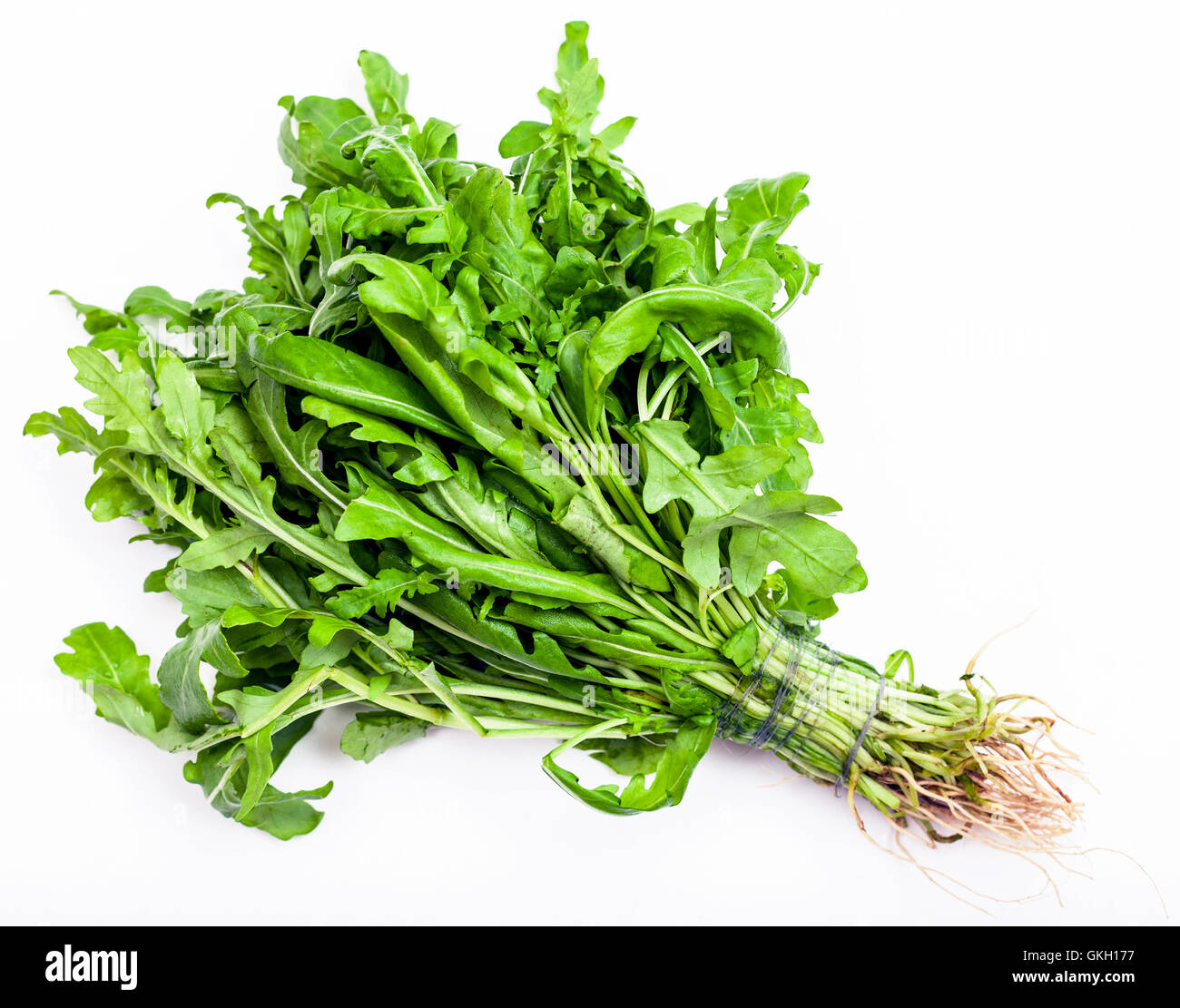 Stock Photo Bunch Of Fresh Cut Green Salad Rocket Herb On White Background